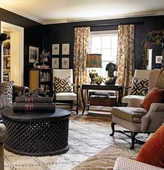 Berber rug, african coffee table, kuba cloth pillows and english armchairs