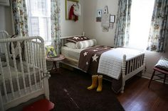 Big boy bedroom. Vintage cowboy with Jenny Lind bed. (cute, but white in boys room????)
