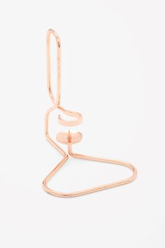 COS image 2 of HAY Lup table candle holder in Copper Triangle Copper Interior, Modern Candle Holders, Unique Home Accessories, Copper Rose, Rose Gold, Timeless Elegance, Gold Material, Contemporary Fashion, Innovation Design