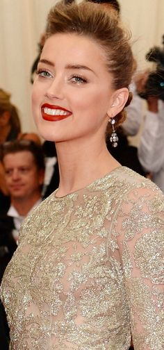 Amber Heard  is wearing a Giambattista Valli dress with Fred Leighton earrings and bracelets. #MetGala2014