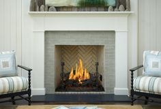 Fireplace surround that feels clean, classic, and warm all at the same time.   Ann Sacks Foundation Brick tile collection in moss