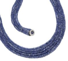 A multi-strand sapphire bead necklace with a sapphire and diamond clasp: Composed of four strands of graduated sapphire beads, the clasp set with an oval-cut sapphire within a brilliant-cut diamond...