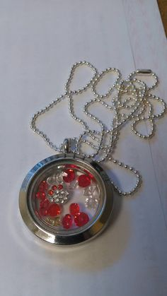 Check out this item in my Etsy shop https://www.etsy.com/listing/234179527/memory-clear-charm-locket-with-a-crystal