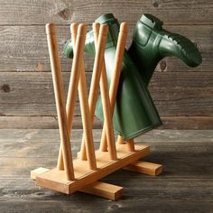 Boot Holder from Williams Sonoma. Could easily be whip up by using some old dowels, or table legs and a drill bit. :)