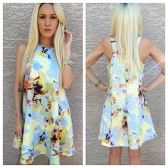 "•Abstract floral print mini Dress• •A sunny abstract floral print gives a cheerful jolt of color to a swingy, tank-style mini dress• The perfect addition to every woman's wardrobe. 33"" length. Hidden back-zip closure. Tulle lined. 97% polyester, 3% spandex. Neoprene style material for putter shell. JOA Dresses Mini"