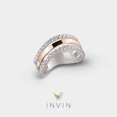 NEVA RING Sleek Classic: Silver and 9kt. Rose Gold Ring with Cubic Zirconia. The chic rose gold arches of this ring evoke the many bridges that rise over the River Neva in St Petersburg. Imagine yourself by the river's edge on a hot summer night, this elegant ring on your finger. Rhodium plated silver and cubic zirconia make this ring a cool, sleek classic.