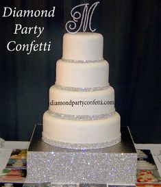 Edible diamonds and Square Rhinestone Crystal Wedding Cake Centerpiece Stand... Talk about Bling!