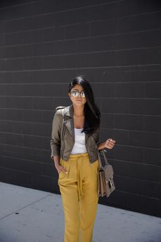 Yellow high waisted pants + moto crop leather jacket + white tank top