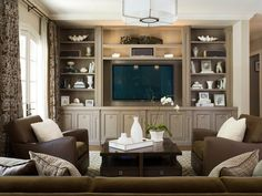 """Nice media wall; understates the TV impact. (designer recommends 36"""" H for base, 20-24"""" deep) Note the column detail on either side of the TV and in center."""