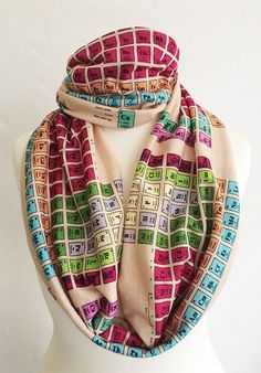 Soft and warm Periodic Table scarves. Sewn into a loop, and worn as an infinity scarf. Measures 9inches by 57inches Please note, Rooby Lane items a...