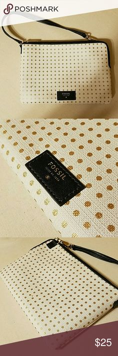 """Fossil Wristlet White with gold dots Fossil Wristlet,  approximately  4 1/2"""" by 6 1/2"""" handle in great condition, small stain on back that can be cleaned. Opens with zipper, also has 4 slot card holder inside. Inside is black. Fossil Bags Clutches & Wristlets"""