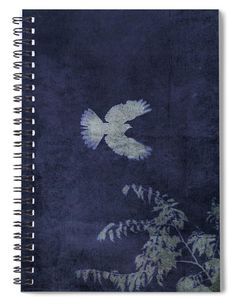 Doves Flight Indigo Spiral Notebook Journal by Lesa Fine Dove in flight in reversed silhouette style with indigo tint. Photography digitally enhanced used as cover art. Perfect size for those who Journal, document travels, note favorite recipes or make notation of their dreams or tasks. Tons of uses. We have a wide array of cover art to suit your topic. This image also available in teal and red/white. #spiralnotebook #journal #diary #dove #art #journaling #gifts #giftideas #productsforsale