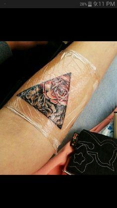 Flower triangle tattoo