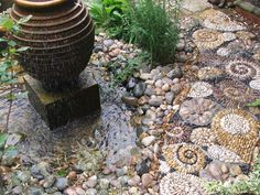 https://flic.kr/p/cTRojj | DSCF9851 | Garden feature path of abstract snails created in pebble by Olicana Mosaics