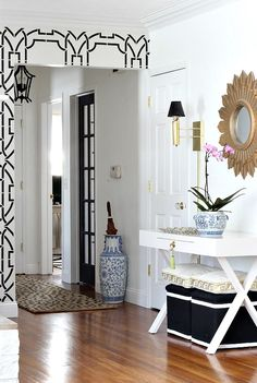 Chic, modern foyer with stenciled walls, a sunburst mirror, white lacquered console table and potted orchid Foyer Decorating, Decorating Your Home, Decorating Ideas, Decor Ideas, Small Hallways, H & M Home, Transitional House, Apartment Living, Interior Design Living Room