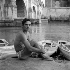 """Pier Paolo Pasolini on the asphalt of the Tiber. Ph: Toti Scialoja, circa """"The cinema is an explosion of my love for reality. Herbert List, Pier Paolo Pasolini, Yul Brynner, St Sebastian, Jean Cocteau, Fire Island, Maria Callas, Moving Pictures, Venice Beach"""
