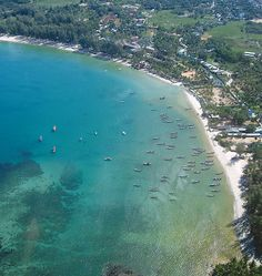 Aerial views of Bangtao Bay on Phuket's on northwestern coast, one of the island's longest beaches. The luxury 5-hotel Laguna complex of which several are beachside. There are plenty of tourist facilities available including the Laguna Phuket Golf Club.