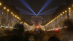 Revellers gather near the Arc de Triomphe on the Champs-Elysees Avenue in Paris (one hour ahead of Greenwich)