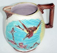 Hey, I found this really awesome Etsy listing at https://www.etsy.com/listing/113608466/lovely-antique-majolica-pitcher-circa