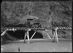 This is the Piha Tramway, which ran from 1906 along the Tasman Sea on the North Island of New Zealand, teetering around large volcanic outcroppings on a narrow gauge rail line as the notorious surf battered its foundations. Nz History, Family History, Steam Railway, Old Trains, Beneath The Surface, Felder, Ol Days, Auckland, Locomotive
