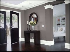 Dark wood, gray walls and white trim.. would love to do the colors of this.
