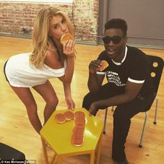Chowing down: It wasn't all hard work for Charlotte as her partner Keo Motsepe posted a photo of them posing with hamburger buns on his Twitter