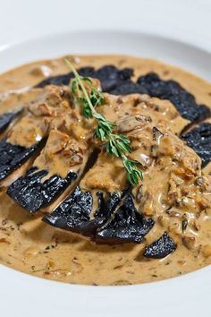 Grilled Portobello Mushroom in a Porcini Cream Sauce.  Serve over egg noodles or dip warm bread into the sauce and enjoy :)
