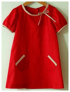 Bouillabaisse Dress (I like the way the bias tape is sewn the opposite way from the usual, the continuous placket and the little embroidery floss button loop)