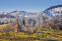 Countryside landscape with traditional Romanian mountainous hamlet and snow covered hills in Moeciu, Brasov county, Trasylvania region, Romania. - Download From Over 28 Million High Quality Stock Photos, Images, Vectors. Sign up for FREE today. Image: 48956648