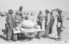 Soldiers with a Type 82 Kubelwagen serving with the Afrika Korps forces during 1942