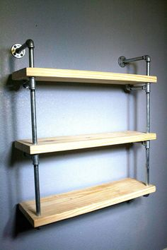 Our originally designed industrial pipe wall shelf, featured in the RAW is an exciting addition to an already inspiring line of custom shelving. This unit is available AS SHOWN and is not customizable