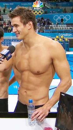 nathan adrian -Michael phelps I would rather meet. But Adrian if rather look at :)
