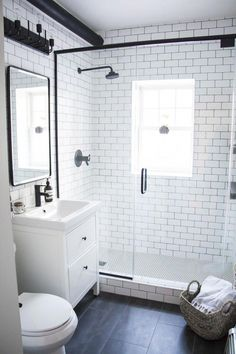A Modern Meets Traditional Black and White Bathroom Makeover - Kristina Lynne A dramatic before and after transformation in this heritage home. Check out this black and white bathroom that marries modern and traditional! Bathroom Tile Designs, Bathroom Interior Design, Bathroom Ideas, Bathroom Storage, Bathroom Pictures, Bathroom Organization, Bathroom Inspo, Bathroom Layout, Wall Storage