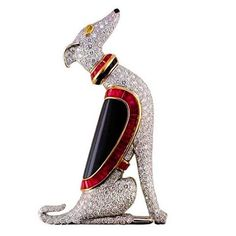 jacquie_jewelsSitting pretty! For all you dog lovers out there, How darling is this diamond and ruby pin by Oscar Heyman? @oscarheyman