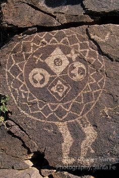 "A petroglyph of a headless ""shield man"" represents a mysterious link to the Anasazi people who left it behind in the Galesteo River Basin near the village of Galesteo, New Mexico"
