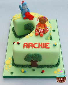 A No 2 shaped cake designed for Archie's Birthday. Hand modelled Iggle Piggle and Upsy Daisy with the cake decorated with trees, stepping stones and little bugs - a boys version of my previous In the Night Garden Cake (no flowers! Garden Birthday Cake, 1st Birthday Cakes, Birthday Ideas, Tall Cakes, Garden Cakes, Jelly Cake, Summer Cakes, Night Garden, Character Cakes