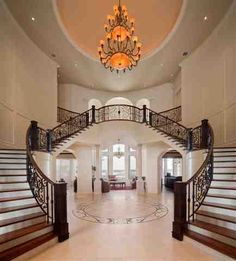 Ravelais: French Castle luxury home design by John Henry Architect Luxury house grand foyer double stairway luxury home plan design