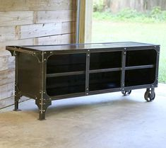 This Modern Industrial original design is a unique piece that can be used as a mobile media console cart or flexible storage in your home. Very maneuverable with a handle on the left and casters on the right. Simply lift and move around. A protective clear coat finish highlights the