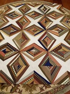 Love this use of plaid beautiful string quilt.Pattern for this available on Bonnie Hunter's web site. Log Cabin Quilt Pattern, Quilt Block Patterns, Quilt Blocks, 24 Blocks, Plaid Quilt, Tie Quilt, Quilting Projects, Quilting Designs, Quilt Design