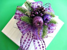 Purple glitter bow with apple ornaments and pine cone by jandavis2, $12.00