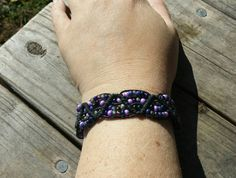 $18.00 Check out this bracelet in my etsy shop! Use coupon code PINSHIP to receive free shipping on orders of $10.00 or more! https://www.etsy.com/listing/182357011/beaded-hemp-bracelet-with-purple-seed