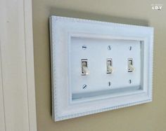 dress up light switches with frames - great idea!