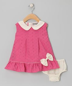 This pretty dress shows off dainty eyelet detailing, a ruffled hem and a bitty bow in front. A matching diaper cover keeps bitty bums comfy in lightweight cotton. The look is classic, charming and cute as a button.