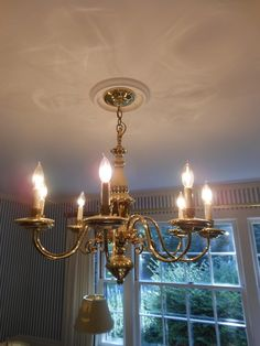 Add timeless elegance to your room with this brass six-arm chandelier.