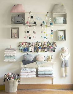For a larger store purchase, mix the knits with Petit Home items.  We used boxes and shelves from the Container Store.  Place the mini dolls in between the wall and a dowel rod.