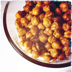 Sweet and Salty Toasted Chickpeas    1 can of chickpeas, drained  1 tblspn of olive oil  1 tsp of brown sugar  1/2 tsp of garlic powder  1 1/2 tsp of cumin powder  salt and pepper to taste    1. preheat oven to 450 and line a baking pan with parchment powder.  2. spread the chickpeas out onto  parchment paper in a single layer and bake for 20 minutes.  3. meanwhile, mix the oil and spices in a bowl. Once the chickpeas are toasted, add them to the bowl, while still warm, and toss until coated...