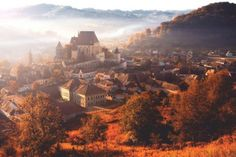 Morning fog over the village of Biertan. Why Romania should be your next holiday destination Beautiful Places To Visit, Places To See, Amazing Places, Chateau Medieval, Visit Romania, Romania Travel, Next Holiday, Loire, Holiday Destinations