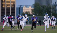 Omaha North 36, Omaha Central 28: Central's Jacobe Hollingsworth takes off on a first quarter first down run on Oct. 3, 2014. By: MARK DAVIS/THE WORLD-HERALD