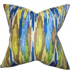 This multicolored pillow is a perfect statement piece to add in your interiors for a contemporary touch. This toss pillow features a unique geometric pattern in shades of blue, green, brown, yellow and white. With its modern and versatile detail, it complements most settings and themes. Crafted with 100% soft polyester fabric and made in the USA. $55.00 #pillows #ikat #homedecor #interiorstyling