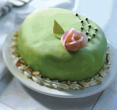 Princess Torte Raspberry and Bavarian Cream layered with genoise (egg-rich golden cake) and wrapped in pastel marzipan. Requires refrigeration.